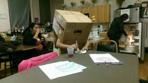 Picture of kids making robots out of boxes at God's Closet